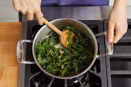 <b>Finish the greens: </b>Add 1/2 cup of water (carefully, as the liquid may splatter) to the pot; season with salt and pepper. Loosely cover the pot with foil and cook, stirring occasionally, 5 to 7 minutes, or until the greens are wilted. Remove the foil and continue to cook, stirring occasionally, 1 to 2 minutes, or until most of the water has cooked off. Turn off the heat; stir in the cilantro pesto. Taste, then season with salt and pepper if desired.