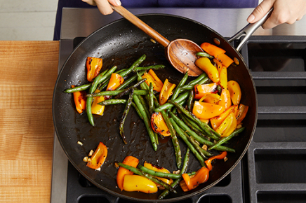 <strong>Cook &amp; finish the vegetables:</strong> In a large pan (nonstick, if you have one), heat 1/2 teaspoon of olive oil on medium-high until hot. Add the prepared green beans in an even layer. Cook, without stirring, 2 to 3 minutes, or until lightly browned. Add the quartered sweet peppers; season with salt (optional) and pepper. Cook, stirring occasionally, 4 to 5 minutes, or until slightly softened. Add the chopped garlic; season with salt and pepper. Cook, stirring frequently, 1 to 2 minutes, or until slightly softened. Add 1/4 cup of water (carefully, as the liquid may splatter). Cook, stirring frequently, 1 to 2 minutes, or until the water has cooked off. Transfer to a large bowl. Add the chopped piquante peppers and season with salt (optional) and pepper. Stir to combine; cover with foil to keep warm. Wipe out the pan.