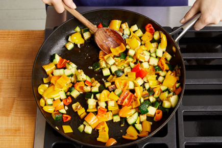 <b>Cook the vegetables: </b>In a large pan (nonstick, if you have one), heat 1 tablespoon of olive oil on medium-high until hot. Add the diced zucchini in an even layer. Cook, without stirring, 3 to 4 minutes, or until browned. Add the chopped garlic and diced sweet peppers. Cook, stirring frequently, 2 to 3 minutes, or until softened. Transfer to a bowl; cover with foil to keep warm. Wipe out the pan.