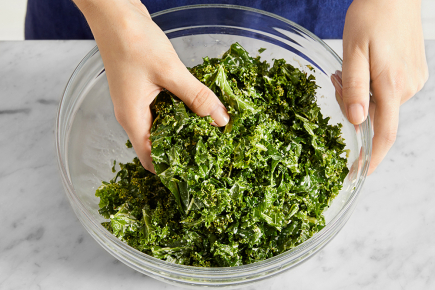 <strong>Marinate the kale:</strong> To the bowl of dressing, add the sliced kale; season with salt and pepper. Stir to coat. Using your hands, massage the kale to slightly soften. Set aside to marinate, stirring occasionally, at least 10 minutes.