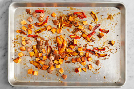 <b>Prepare & roast the vegetables: </b>Place an oven rack in the center of the oven, then preheat to 450°F. Wash and dry the fresh produce. Cut off and discard the stems of the sweet peppers; remove the cores, then quarter lengthwise. Medium dice the sweet potato. Combine the chile powder, paprika, garlic powder, cumin, and oregano in a small bowl. Place the prepared vegetables on a sheet pan. Drizzle with 1/2 teaspoon of olive oil and season with salt (optional), pepper, and half the spice blend; toss to coat. Arrange in an even layer. Roast 17 to 19 minutes, or until browned and tender when pierced with a fork. Remove from the oven.