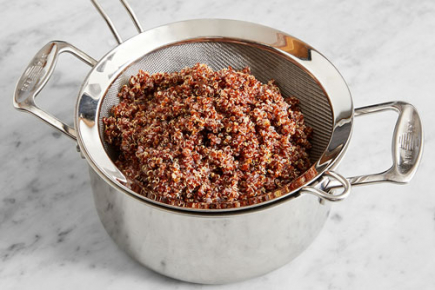 <b>Cook the quinoa: </b> Add the quinoa to the pot of boiling water. Cook, uncovered, 18 to 20 minutes, or until tender. Drain thoroughly and transfer to a large bowl; cover with foil to keep warm.