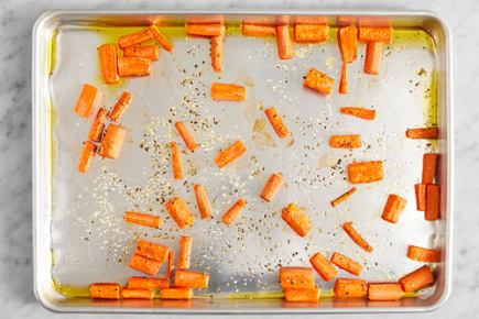<b>Roast the carrots: </b>Meanwhile, place the carrot pieces on a sheet pan. Drizzle with 1/2 teaspoon of olive oil; season with salt (optional) and pepper. Roast 15 to 17 minutes, or until browned and tender when pierced with a fork. Remove from the oven.