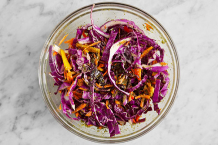 <b>Prepare & make the slaw: </b>Wash and dry the fresh produce. Cut out and discard the core of the cabbage; thinly slice the leaves. Peel the carrots and grate on the large side of a box grater. Cut off and discard the stems of the peppers; remove the cores, then thinly slice lengthwise. Combine the prepared vegetables in a large bowl; add the cilantro pesto. Season with salt (optional) and pepper; stir to coat. Set aside to marinate, stirring occasionally, at least 10 minutes.