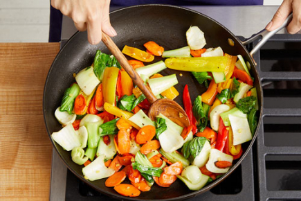 <b>Cook the vegetables: </b><br>In a large pan (nonstick, if you have one), heat the sesame oil on medium-high until hot. Add the sliced carrots and quartered peppers; season with salt (optional) and pepper. Cook, stirring occasionally, 4 to 5 minutes, or until slightly softened. Add the chopped bok choy and chopped ginger. Season with salt (optional) and pepper. Cook, stirring occasionally, 3 to 4 minutes, or until slightly softened. Transfer to a bowl and cover with foil to keep warm. Wipe out the pan.