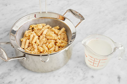 <b>Cook the pasta: </b>Add the pasta to the pot of boiling water. Cook, stirring occasionally, 4 to 6 minutes, or until al dente (still slightly firm to the bite). Turn off the heat. Reserving 1 cup of the pasta cooking water, drain thoroughly and rinse under cold water to prevent sticking. Return to the pot.