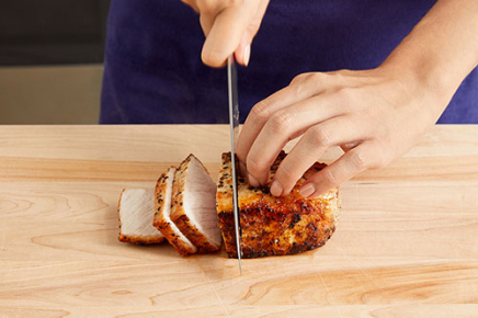 <strong>Slice the pork &amp; serve your dish:</strong> Find the lines of muscle (or grain) on the rested pork; thinly slice crosswise against the grain. Serve the sliced pork with the roasted vegetables. Top the pork with the glazed apple. Enjoy!