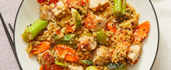 Pork & Freekeh Stir Fry with Brussels Sprouts, Carrots, and Shishito Peppers