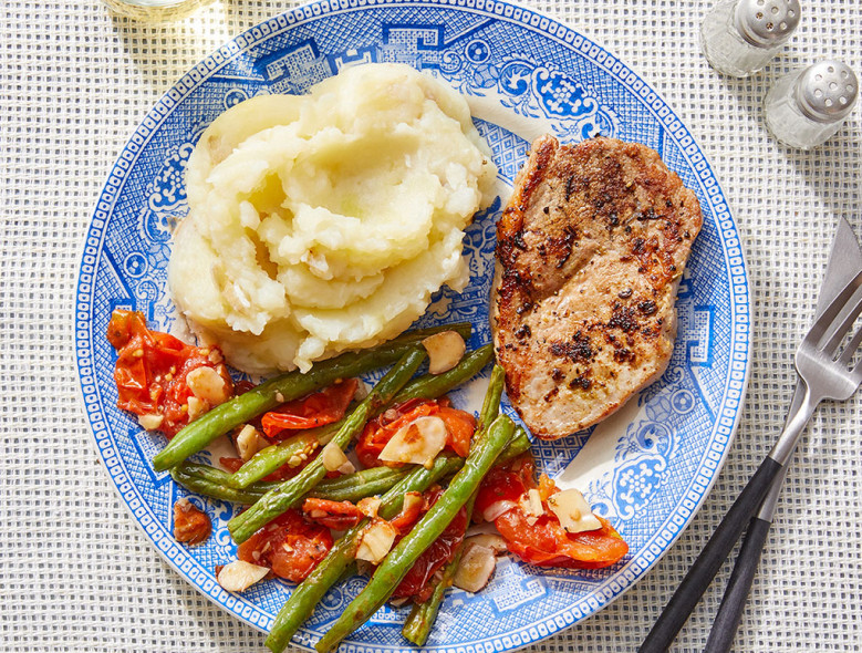 Tuscan-Spiced Pork & Mashed Potatoes with Green Beans and Roasted Tomato Dressing