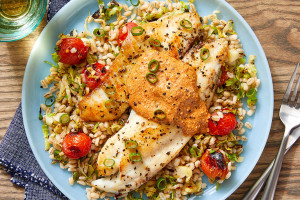 Tilapia & Creamy Romesco Sauce with Barley, Tomatoes, and Brussels Sprouts