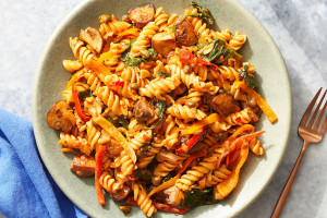 Chickpea Pasta & Calabrian Tomato Sauce with Mushrooms, Spinach, and Peppers