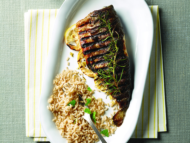 Grilled Trout With Fresh Herbs And Lemon Slices