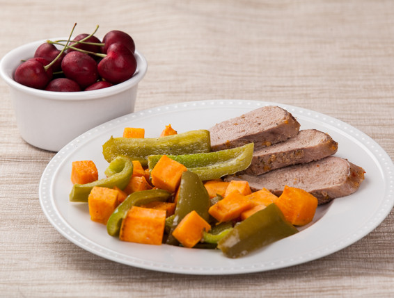 Spicy Apricot-Glazed Pork with Sweet Potatoes and Peppers